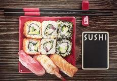 Rolls e sushi e hashi Imagens de Stock