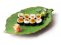 Rolls with eel, caviar, tofu and cucumber. In green leaf plate over white background Royalty Free Stock Photography
