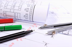 Rolls of electrical diagrams and accessories for drawing Stock Photos