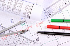 Rolls of electrical diagrams and accessories for drawing Stock Images