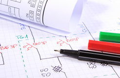 Rolls of electrical diagrams and accessories for drawing Stock Image