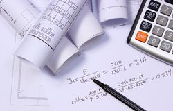 Rolls of electrical diagrams, calculator and mathematical calculations Stock Images