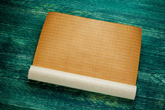 Rolls of empty blueprint on green wooden board. Top view Royalty Free Stock Photo