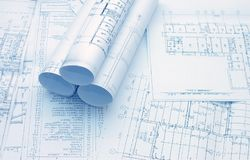 Rolls of Engineering Drawings. Closeup royalty free stock images