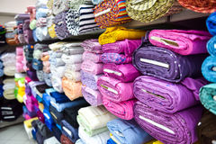 Rolls of fabri and textiles in a factpory shop. Stock Image