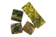 Rolls of fabric camouflage pattern stretchable bandage tape isolated on white background. Closeup rolls of fabric camouflage pattern stretchable bandage tape royalty free stock photography