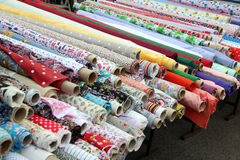 Rolls of fabric material at market Royalty Free Stock Photos