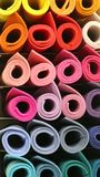 Rolls of fabric in the rack of the tailoring. Many colored big rolls of fabric in the shelf of the tailoring Stock Photo
