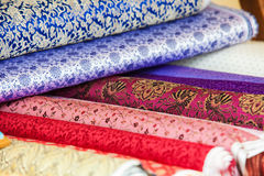 Rolls of fabric and textiles in a factory shop Royalty Free Stock Photo