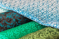 Rolls of fabric and textiles in a factory shop Royalty Free Stock Images