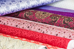 Rolls of fabric and textiles in a factory shop royalty free stock photography