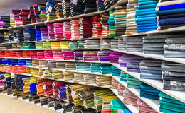 Rolls of fabric and textiles in a factory shop or  store Stock Photography