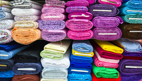 Rolls of fabric and textiles in a factpory shop. Stock Images