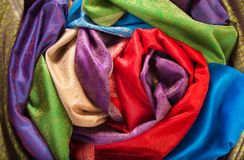Rolls of fabrics on the table Royalty Free Stock Image