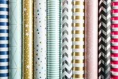 Rolls of festive wrapping paper as background royalty free stock photography