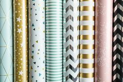 Rolls of festive wrapping paper as background. Top view royalty free stock photos