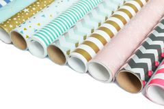 Rolls of festive wrapping paper on white background. Space for text royalty free stock images