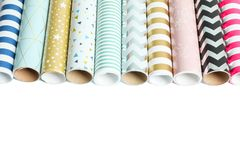 Rolls of festive wrapping paper on white background. Space for text stock photo