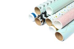 Rolls of festive wrapping paper on white background. Space for text royalty free stock photo