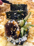 Rolls with fish and cucumber with sesame and crispy breading stock photo