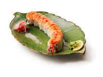 Rolls with fried shrimp, salmon, eel... Rolls with fried shrimp, salmon, eel end slice of lemon in green leaf plate over white background Stock Image