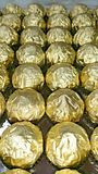 Rolls of golden foil wrappers Stock Photo