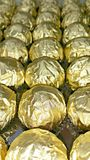 Rolls of golden foils Stock Image