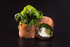 Rolls with greens and salmon royalty free stock image