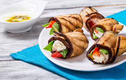 Rolls of grilled slices of eggplant with feta cheese and tomato Royalty Free Stock Photo