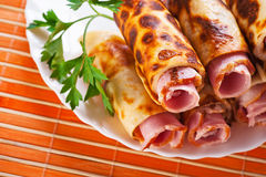 Rolls with ham (bacon, sausage) stock photo