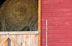 Rolls of Hay in Red Barn Stock Image
