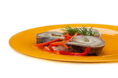 Rolls of herring with pickled cucumber and pepper Stock Image