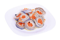 Rolls from a herring on a plate isolated Royalty Free Stock Photo