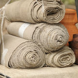 Rolls of a homespun fabric Stock Image