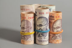 Rolls of Indian rupees isolated Stock Images
