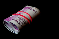 Rolls on indian 2000 rupees notes Royalty Free Stock Photo