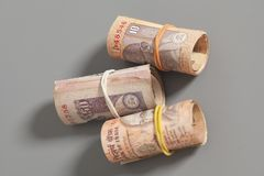 Rolls of Indian rupees. On a gray background Stock Image