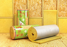 A rolls of insulation glass wool on a wood background. Insulatio Royalty Free Stock Photo