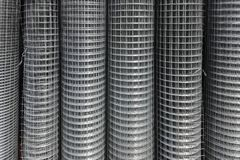 Rolls of iron grid use for reinforce concrete in construction site.. Metal mesh in rolls. Close-up stock photo