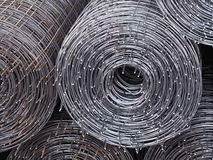 Rolls of iron mesh. Rolls of iron mesh, Iron mesh to strengthen a construction when cement is poured stock images