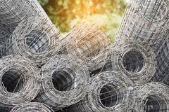 Rolls of wire mesh. Iron steel. Rolls of iron wire mesh using for reinforce concrete in construction site. Rolls of wire mesh. Iron steel Industry concept Stock Photography