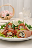 Rolls of jamon with blue cheese in lettuce leaves and parmesan Stock Photography