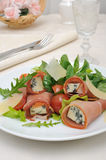 Rolls of jamon with blue cheese in the mix of lettuce with Parme Stock Photo