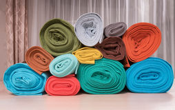 Rolls of knitted fabric Stock Photos