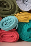 Rolls of knitted fabric in assortment Stock Photos