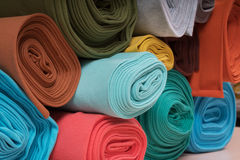 Rolls of knitted fabric in assortment Royalty Free Stock Photography