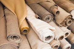 Rolls of  linen cloth lie on counter. Rolls of  linen cloth lie on the market counter Royalty Free Stock Photography