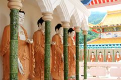 Rolls of Mahayana-styled Buddhas along the Cloister Stock Photography