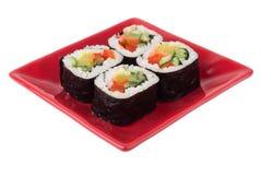 Rolls med grönsaker på plattan Royaltyfri Foto