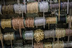 Rolls of colorful metal chains as a background. Rolls of metal chains as a background texture stock photography